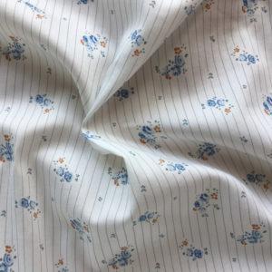 tissu coton paulinette fleurs bleu caramel